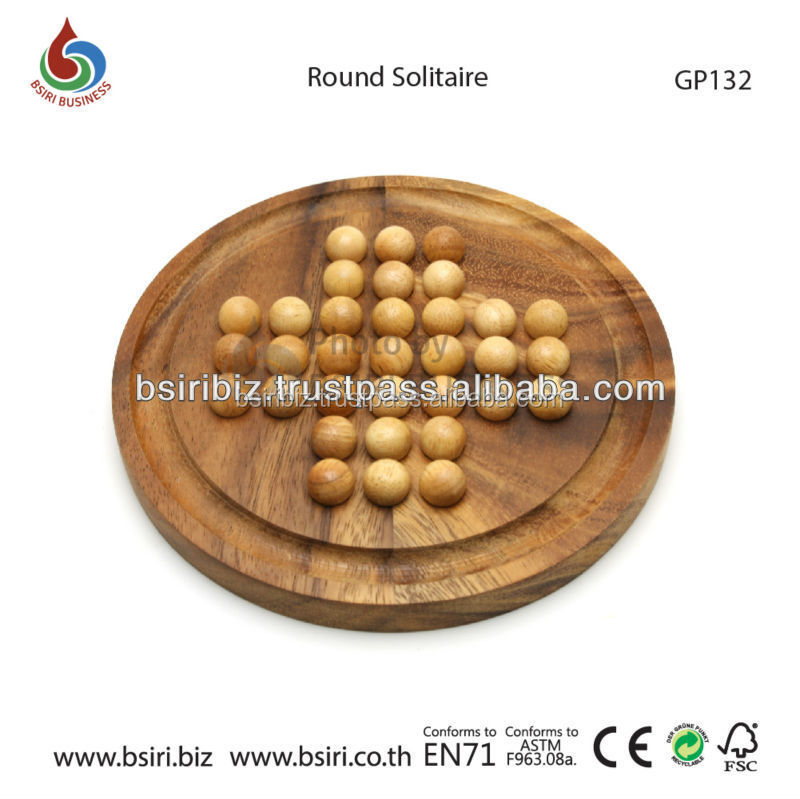 Round Solitaire Game Board in Wood with wooden Marbles