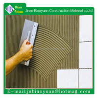 Polymer modified cement based grey-coloured powder tile adhesive