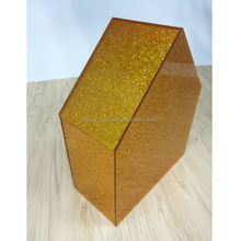Shiny gold and brown acrylic roof panels