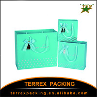 Wholesale custom paper packaging bags with logo with handles