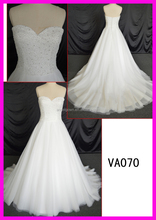 Peal beaded bodice ball gown wedding dress with sweetheart ruffles button down in back decoration