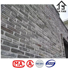 Slim grey historical style building wall reclaimed old brick