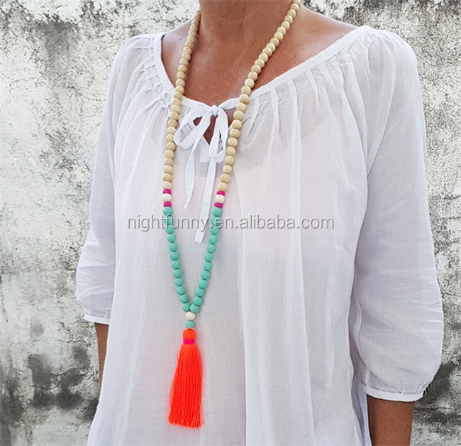 Neon Coral Boho long tassel necklace, teal resin beads, natural wood bead tassel necklace