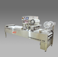 Tray vacuum packing machine for dried fruit peeled