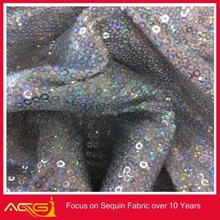 The hot sale top 100 design 100% polyester rotund fair fascinating sequin fabric glow in the dark spandex fabric