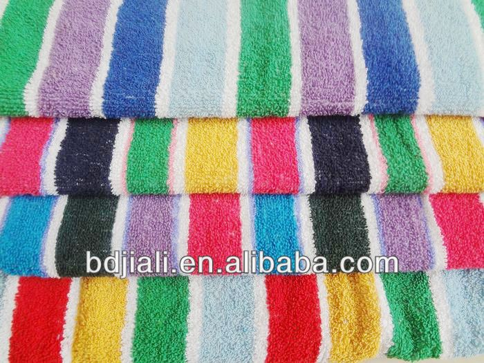 white and pink striped bath towels