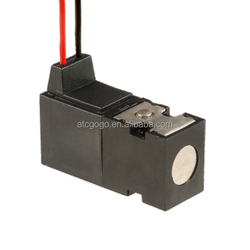 Normally open carefully selected materials latching miniature solenoid operated valve