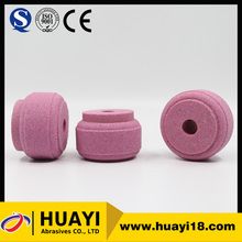 Non-conventional pink drum shaped vitrified bonded grinding wheels