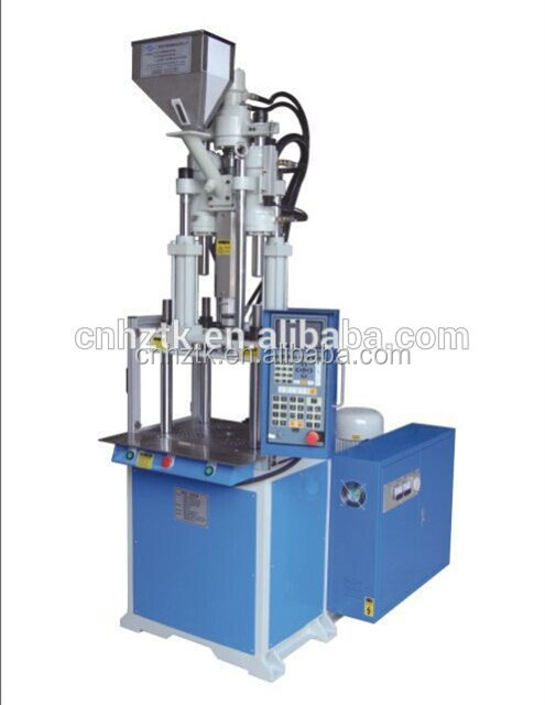 Supply the V4-35 vertical plastic injection machine