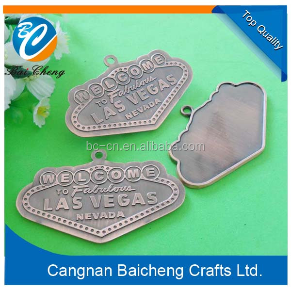 1 hole metal labels with unique brand name and logo of factory price for advertising and promotion use