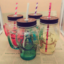 Machine made cheap price glass skull jars with straw with handle