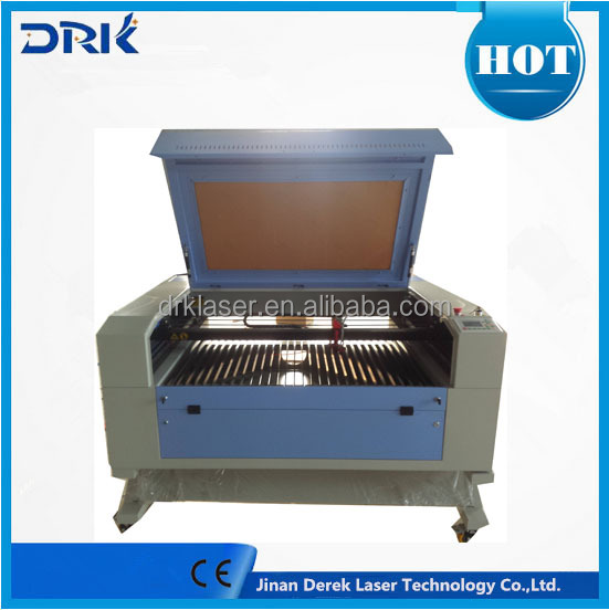 Jinan co2 3d mini fabric laser cutter for acrylic wood leather fabric laser cutting machine price