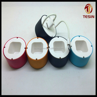 Colorful metal and plastic storage case contains USB charging plug and cables and earphone