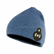 Top quality OEM/ODM selling Bluetooth winter hat with headphone women fur ball knitting beanie