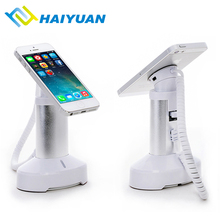 Retail store table security alarm with charging stand mobile phone anti lose holder