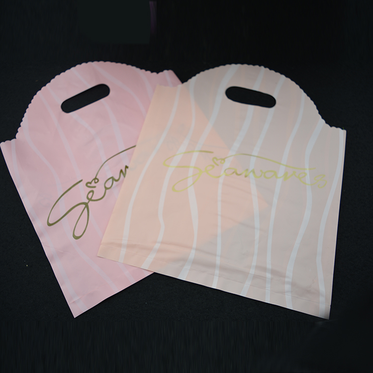 Factory pink poly round shopping bag
