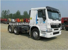 China Best Tractor Truck SINOTRUK HOWO 6x4 371hp 40ton tractor head with 3 axle 40t-60t flat bed container semitrailer
