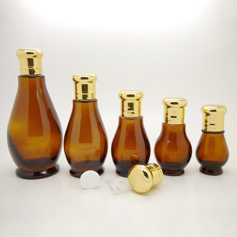 Factory price Customize unique clear glass essential oil bottle