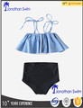 Girl's lovely blue falbala top and high waisted bottom swimsuits.