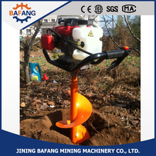 persons used earth auger / hole drill machine / ice auger