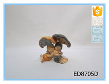 Resin two mushroom baby sculpture with a red hat souvenir gift item