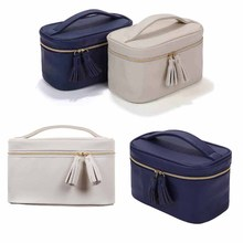 Large capacity solid color travel zipper pu tassel cosmetic bag