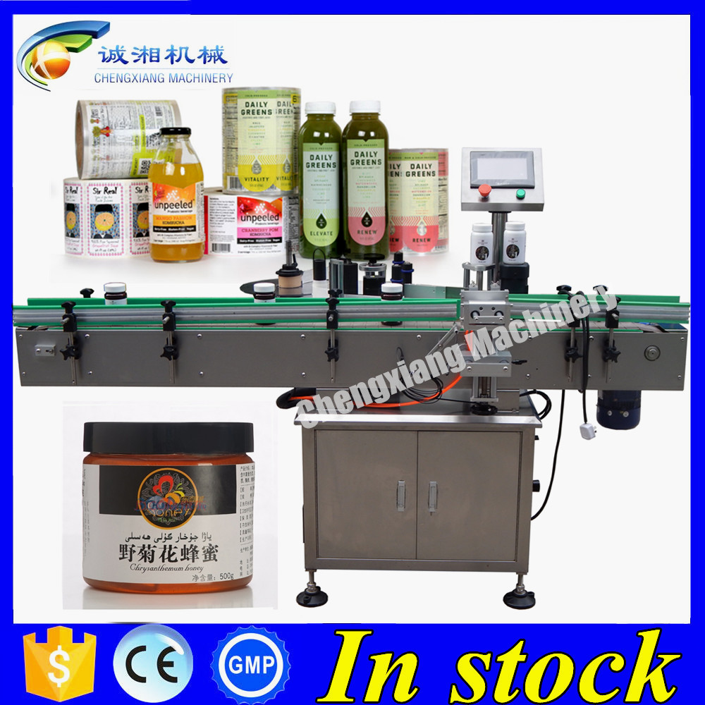 Low price fix position labeling machine,pet round bottles labeling machine