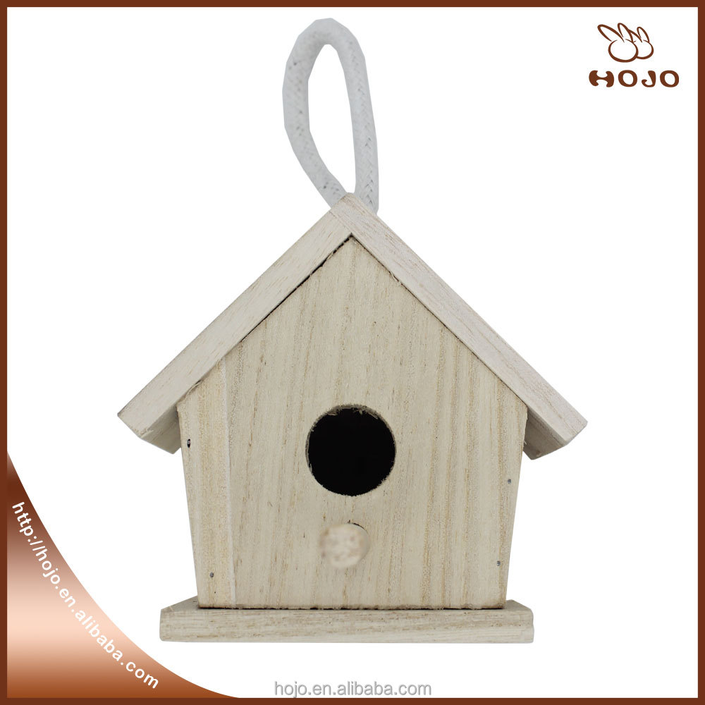 Hanging small wooden bird house for kitchen embellishment