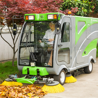 Comfortable cab road sweeper vehicle