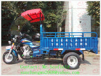 self dumping three wheel cargo motorcycle