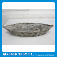 Grey washed boat wicker basket with plastic liner