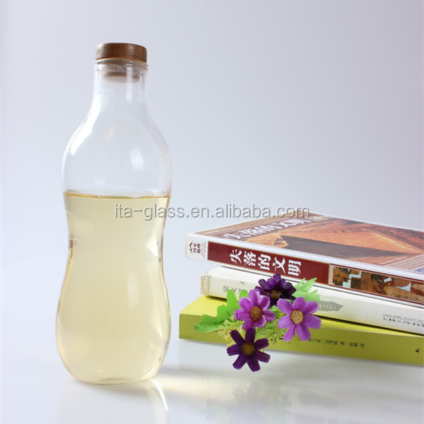 newly glassware manufacturer hand made blown glass drinking bottle bamboo lid cover drinking glass water bottle for sale