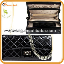 quilted leather clutch bag with chain