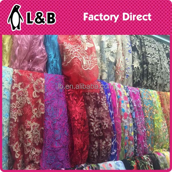 High quality fancy patterned multicolor tulle embroidery wedding dress lace fabric
