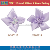 Pre-made satin purple ribbon bow for garment