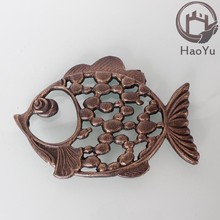 metal cast iron trivet with fish shape