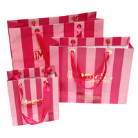 pink stripe gold logo paper shopping bag