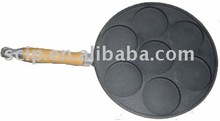 cast iron cake pan with wooden base