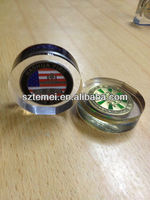clear acrylic paperweight with metal coin