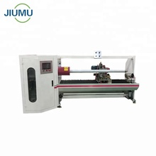 Automatic adhesive tape log roll cutting machine