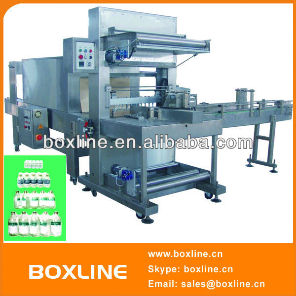 Automatic liquid bottle shrink wrap machine