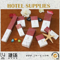 Hotel non-woven material newspaper bag laundry bag and sanitary bag Hotel dental kit with 16cm toothbrush 18cm toothbrush