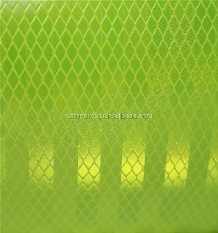 Green micro-prismatic reflective sheeting