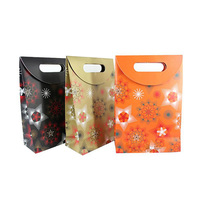 Decorative handmade paper gift bags with ribbon handle