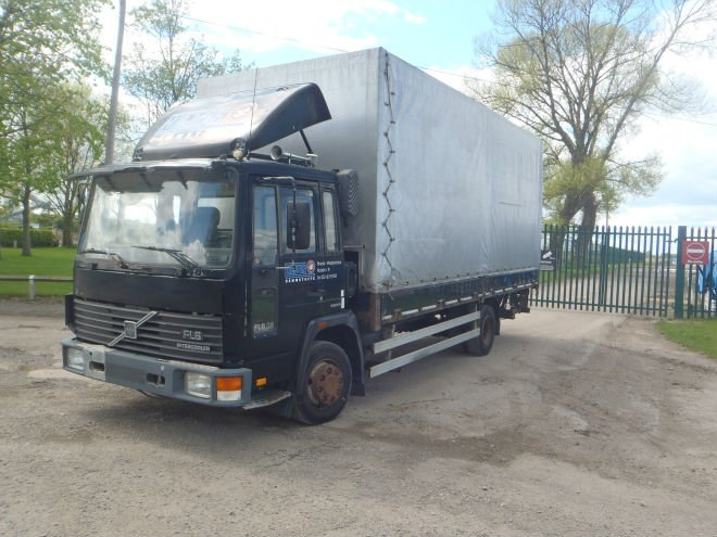 1993 Volvo fl6 left hand drive drop side with curtains and tailgate