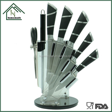 Stainless steel kitchen knife in acrylic stand