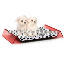 Red M shaped acrylic dog bed with cushion