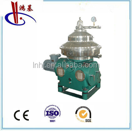 disc centrifuge separator with continuous discharge and feed