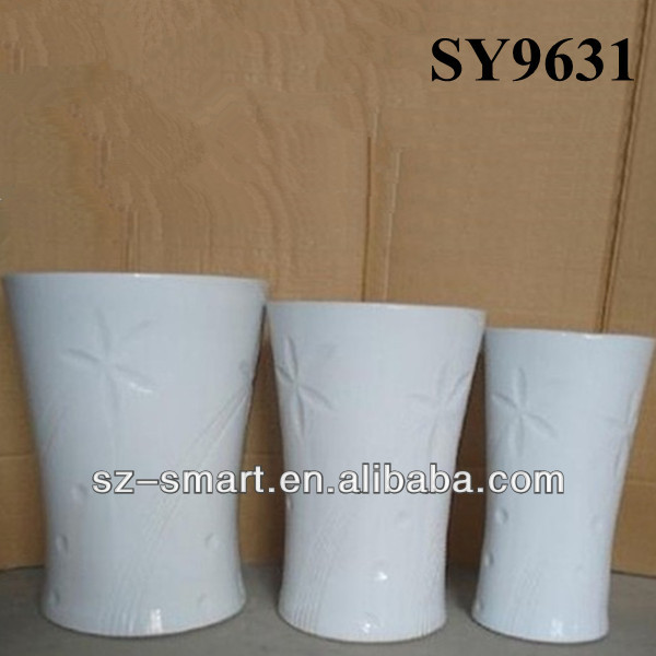 Vertical white garden pots and planters