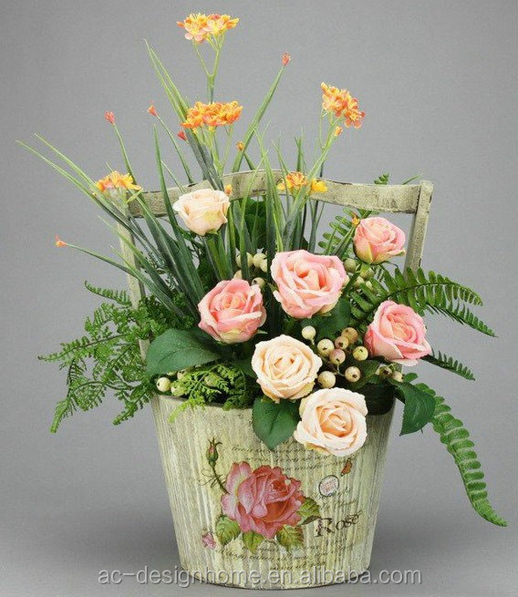 PEACH ROSE & FREESIA ARRANGEMENT ON ROUND IRON PLANTER
